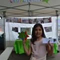 Elisa devant le stand CITOYENNETE avec toutes ses étoiles