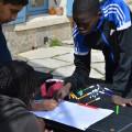 Moussa, Diénéba et Sofiane en pleine reflexion sur leur jeu